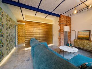 OOIIO Arquitectura Вітальня Керамічні Синій