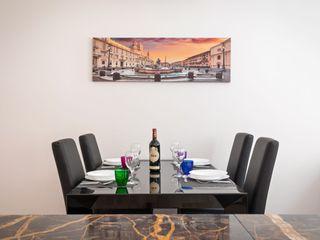 Casa vacanze Flora - 60 MQ Dr-Z Architects Sala da pranzo eclettica Marmo Ambra/Oro