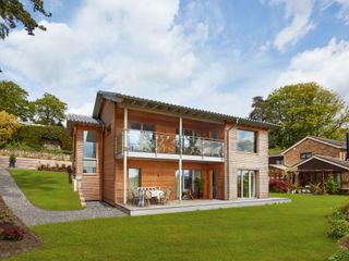House Crowley: a Compact eco Home Baufritz (UK) Ltd. Casas de madera Madera Acabado en madera