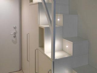 Monolocale Manasardato in Centro Storico Studio di Architettura IATTONI Ingresso, Corridoio & ScaleIlluminazione