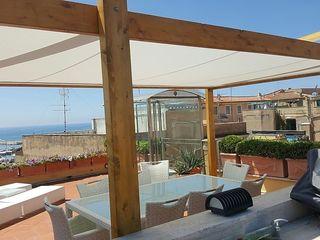 Nido al mare Dr-Z Architects Balcone, Veranda & Terrazza in stile mediterraneo Legno Effetto legno