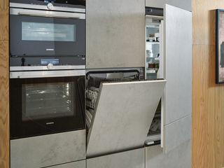 Puristische Inselküche von next125 Spitzhüttl Home Company KücheElektronik