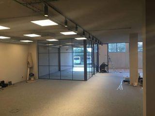 CERPE - Consultores em Engenharia de Reabilitação do Património Edificado Industrial style study/office
