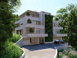 Nachhaltiges Terrassenhaus am Berg Peter Stasek Architects - Corporate Architecture Mehrfamilienhaus Beton Grau