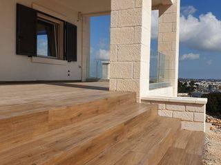 Rifinitura di abitazione privata Quaranta Ceramiche Srl Pareti & PavimentiPiastrelle Ceramica Effetto legno