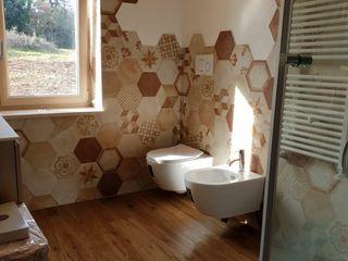 Rifinitura di abitazione privata Quaranta Ceramiche Srl BagnoSedute Ceramica Bianco