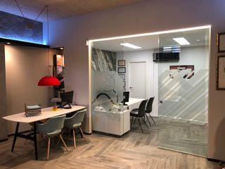 Estudio de Interiorismo Showroom ESTUDIO FRANCIA INTERIORISMO Oficinas y tiendas de estilo ecléctico