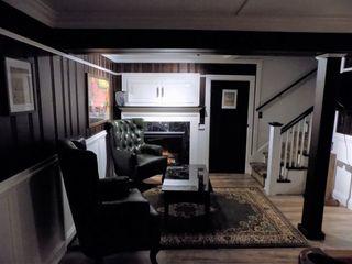 Tonic Interiors Ruang Keluarga Klasik Kayu Brown
