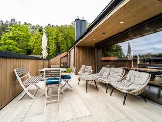 S.N.O.W. Planungs und Projektmanagement GmbH Modern balcony, veranda & terrace