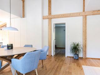 S.N.O.W. Planungs und Projektmanagement GmbH Scandinavian style dining room