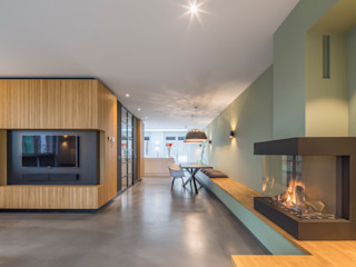 ÈMCÉ interior architecture Ruang Keluarga Modern