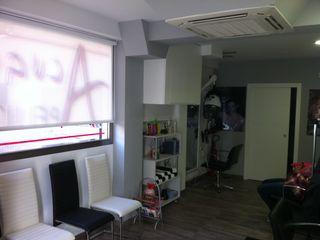 Proyecto y Ejecución de Local para Peluquería ESTUDIO FRANCIA INTERIORISMO Oficinas y tiendas de estilo moderno