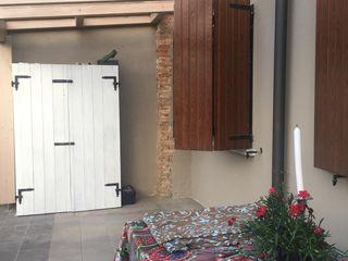 Terrazza in Legno MENGON LEGNAMI SRL Balcone, Veranda & Terrazza in stile classico