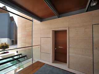 FIRE 60' - Quartiere Le Albere di Renzo Piano a Trento Gasperotti Srl Porte d'ingresso Effetto legno