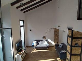 Reforma y Ampliación de vivienda unifamiliar en Valencia OCTANS AECO Salones de estilo moderno