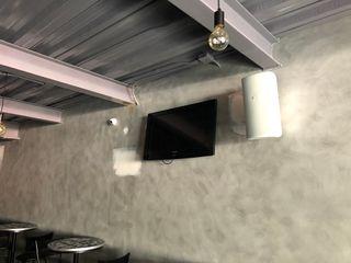 Ataxia Servicios Office spaces & stores Wood-Plastic Composite Grey