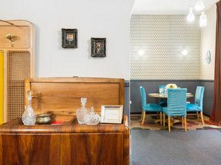 Gentleman's Club Apartment in Rione Monti Tania Mariani Architecture & Interiors Sala da pranzoCredenze & Vetrine Legno Ambra/Oro