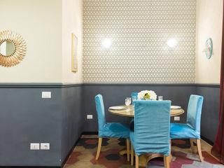 Gentleman's Club Apartment in Rione Monti Tania Mariani Architecture & Interiors Sala da pranzoTavoli Ambra/Oro