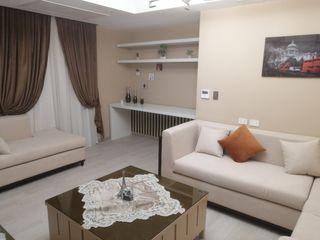 كاسل للإستشارات الهندسية وأعمال الديكور والتشطيبات العامة Modern living room Wood Grey