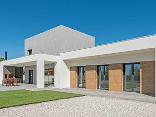 NUÑO ARQUITECTURA Casas unifamiliares Aglomerado Blanco