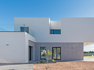 NUÑO ARQUITECTURA Casas unifamiliares Cerámico Gris