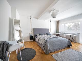 Ferienwohnung Raumblüte SchlafzimmerBetten und Kopfteile