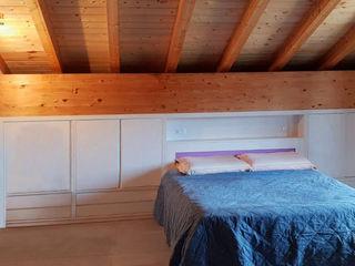 Progetto per camera da letto mansardata Falegnamerie Design