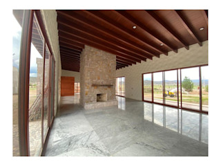 Cervantes Bueno arquitectura Rustic style living room Marble Wood effect