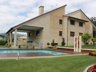 Proyecto de decoración en Vincios-Gondomar ARDEIN SOLUCIONES S.L. Casas unifamilares Piedra Marrón