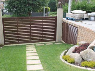 Proyecto de decoración en Vincios-Gondomar ARDEIN SOLUCIONES S.L. Casas unifamilares Aluminio/Cinc Marrón