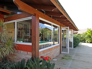 Graça Brenner Arquitetura e Interiores Casas de campo Madeira Acabamento em madeira