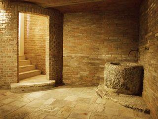 Restauro di una colonica in Chianti Studio Architetto Pontello Cantina rurale Arenaria Trasparente