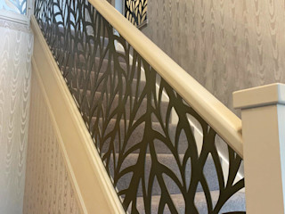 Renovated staircase with laser cut infill - Frond design Staircase Renovation درج معدن