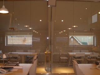 Frameless glass for contemporary offices Ion Glass Minimalist offices & stores Glass