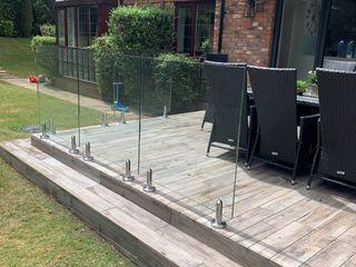 Glass Balustrade project in Salford, Manchester Origin Architectural Ogród zen Szkło Przeźroczysty