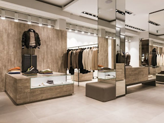 Proyecto de interiorismo para un fashion shop, Padova Michele Mantovani Studio Oficinas y tiendas de estilo moderno Cerámico Beige