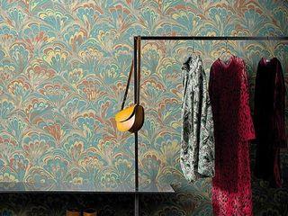 Un tocco di giallo L&M design di Marelli Cinzia Pareti & Pavimenti in stile moderno Giallo