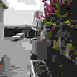 REMODELACIÓN DE TERRAZAS Y INTERIOR DE UN ÁTICO EN ESPLUGUES DE LLOBREGAT Taller de Paisatge Balcones y terrazas de estilo mediterráneo