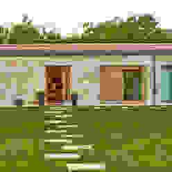 HUGA ARQUITECTOS Casas de estilo rústico