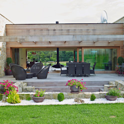 Rustic style house by HUGA ARQUITECTOS Rustic