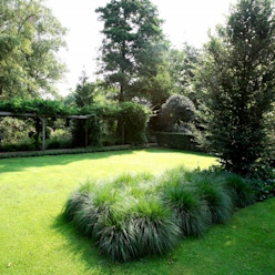 Landscape garden with ornamental grasses lavender and koi in the Netherlands- Landschappelijke onderhoudsvriendelijke tuin met siergrassen lavendel en koi vijvers. FLORERA , design and realisation gardens and other outdoor spaces. Country style garden