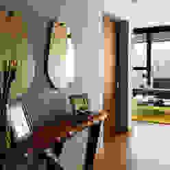 Departamento DG Pasillos, vestíbulos y escaleras modernos de Concepto Taller de Arquitectura Moderno