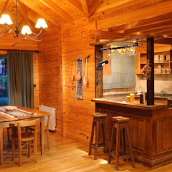Comedores rurales de Patagonia Log Homes - Arquitectos - Neuquén Rural Madera Acabado en madera