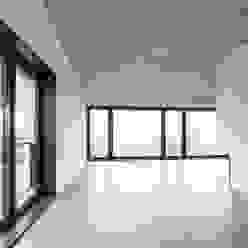 Einfamilienhaus Brunnaderenstrasse / CH-8193 Eglisau Moderne Wohnzimmer von Jäger Zäh Architekten Modern