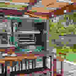 Casa 35 Balcones y terrazas modernos: Ideas, imágenes y decoración de Estúdio Barino | Interiores Moderno