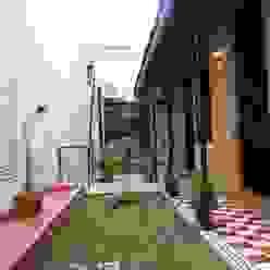 patio después Jardines eclécticos de Parrado Arquitectura Ecléctico