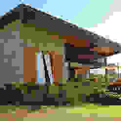 PROJETO CASA DA REPRESA: Casas  por Ambienta Arquitetura ,