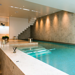 ​Basement pool at Bedford Gardens house. Nash Baker Architects Ltd Pool Stone White