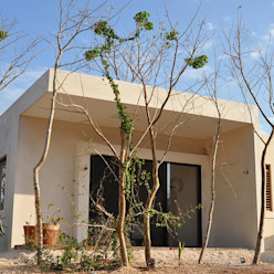 Degetau Arquitectura y Diseño Casas tropicais Fibra natural Bege