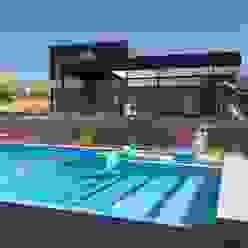 homify Modern pool Concrete Blue